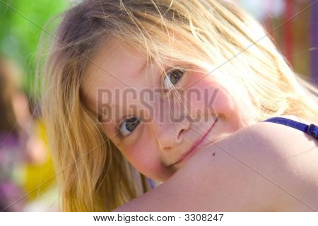 6 Year Old Girl Smiling At The Park