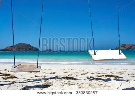 Lombok, Indonesia - September.10.2019: Swing At Kuta Beach, Lombok, Indonesia.