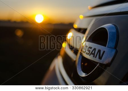 Russia, Volgodonsk-april 09, 2015, Close-up Of Nissan Logo Car With Soft Focus On Blurred Background