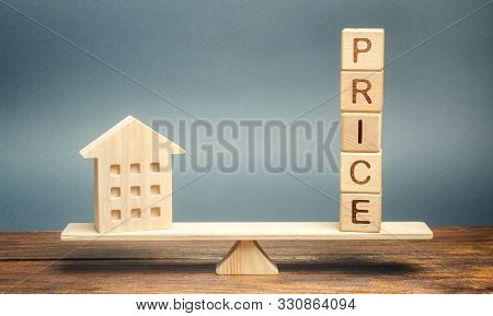 Wooden House And The Word Price On The Scales. Fair Valuation Property Concept. Home Appraisal. Fair