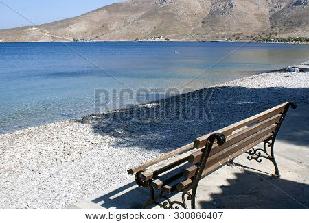 Greece - Tilos Island :  A View Of The Harbor And Bay. A Simple Bench With A View To Sea. A Place To