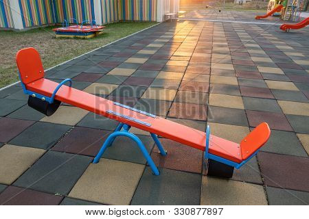 Rubber Coating And Flip Flap Swing At The Playground At Preschool.