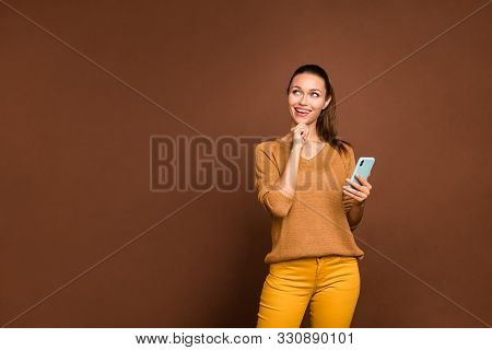 Photo Of Cheerful Nice Cute Dreamy Girl Pensively Looking Up At Empty Space Pondering Over Answering
