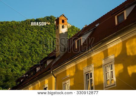 Europe, Romania, Brasov: City sign as seen on Tampa Mountian from Council Square poster