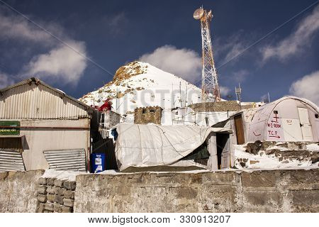 People Stop Car Rest At Check Point Base Camp Top Of The World On Khardung La Road In Himalaya Mount