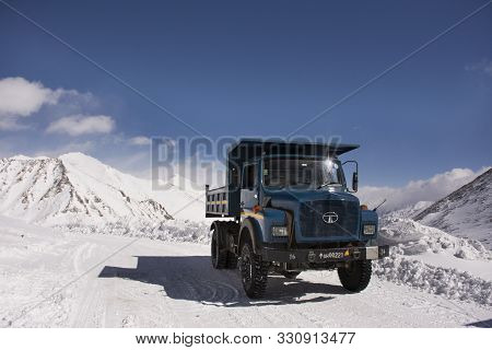 Jammu Kashmir, India - March 21 : Indian And Tibetan Drive Car And Truck On Khardung La Road In Hima