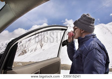 Indian Or Tibetan Driver Rest And Drinking Hot Tea Top Of Mountain On Khardung La Road Go To Nubra V