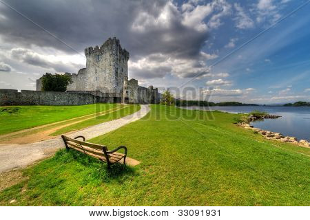 Ross Castle with empty bench near Killarney, Co. Kerry Ireland poster