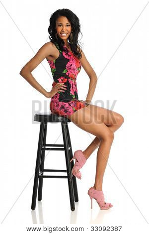 Portrait of beautiful African American woman posing isolated over white background