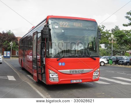 Albi, France - Circa August 2018: Red Bus At A Bus Stop For Mass Transit Public Transport