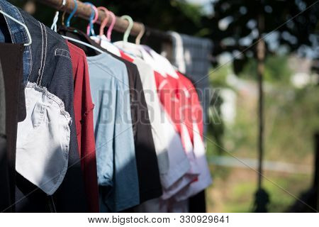 Clothes Hanging On Clothesline For Drying After Laundry. Selective Focus