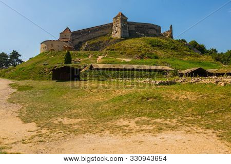 Medieval Walled City Rasnov On Hill, Romania. Autumn Landscape With Medieval Fortification Castle Ra