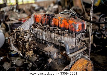 Old Engines Of The Car Are Dirty And Rusty At The Junk Yard