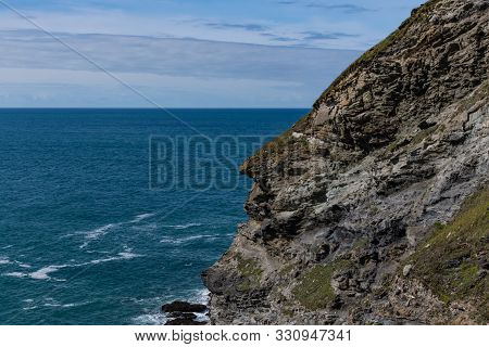 The Face Of King Arthur In Profile On The Cliffs At Tintagel, Cornwall