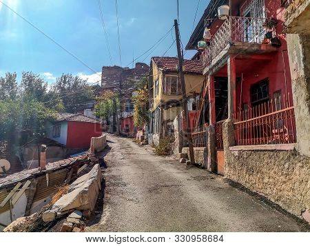 Street With Ancient Huts Near Ankara Castle On An Autumn Sunny Day. Old Colorful Squalid Houses In T