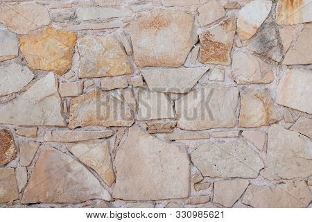 Texture of a stone wall. Old stone wall texture background. Stone wall as a background or texture. G