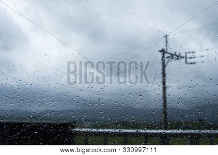Window Glass With Raindrops In Stormy Weather