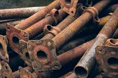 Pipes used for fastening wooden beams during the construction of concrete. Pipes supporting formwork. Metal supports for scaffolding and formwork. Threaded steel pipes for level adjustment. poster