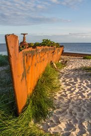 An Old Rusty And Damaged  Batteship Wreck On The  Beach. Hel,  Poland