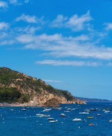 Boats In The Town Bay With Mountain Behind. Tossa De Mar, Spain