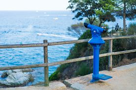 Coin Operated Blue Binocular On Observational Deck With View On The Sea