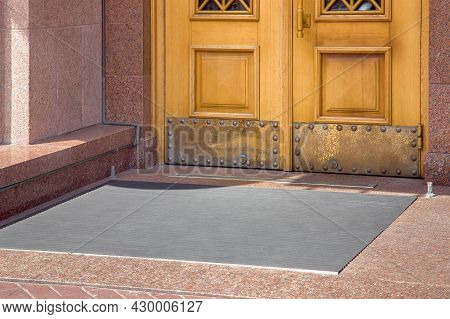 Stone Entrance With Foot Mat At The Entry Door Made Of Wood And Granite Stone Facade Cladding Of Ret