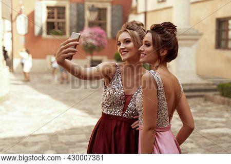 European Girls Take Selfie On Mobile Phone In City