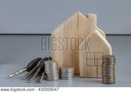Concept Buying New Home. Wooden Houses, Stacks Coins, House Keys. Search Rental Real Estate For Purc