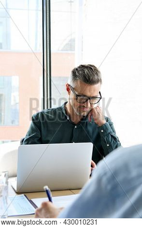 Serious Caucasian Male Ceo In Glasses Looking At Pc Laptop And Over Shoulder View Of Male Manager Di