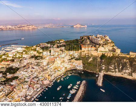Aerial Drone View Of Italian Island Procida. Marina Corricella And Fort