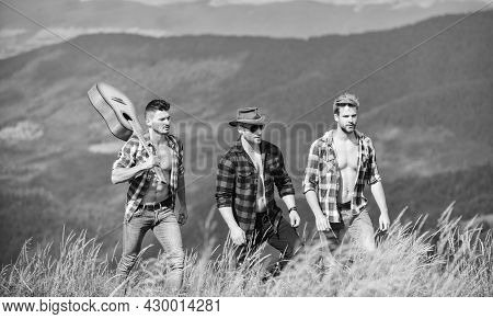 Enjoying Freedom Together. Long Route. Group Of Young People In Checkered Shirts Walking Together On