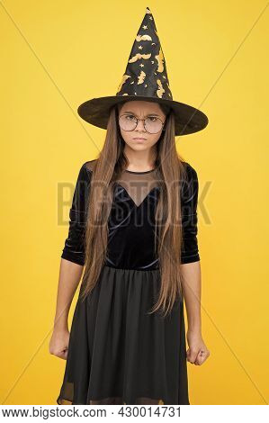 Angry And Unhappy Kid Wear Witch Hat And Glasses Ready For Enchantment On Halloween, Happy Halloween