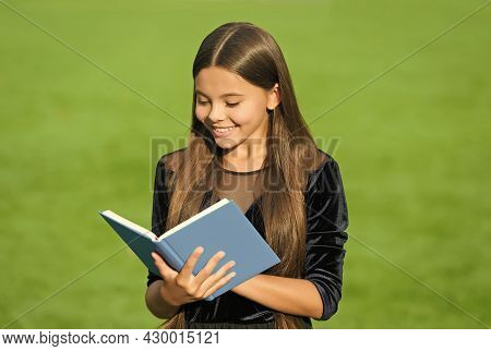 Schooling Is Foundation For Future. Happy Child Read Book Green Grass. Back To School. September 1.