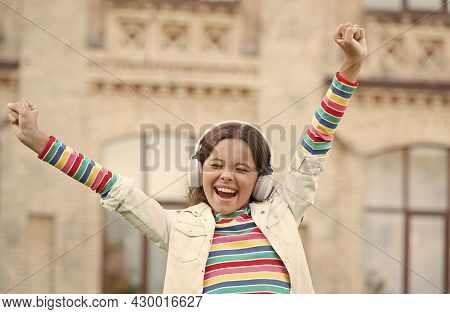 Kid Sing At Schoolyard. Positive And Colorful. Child Has Music Break. Girl In Headphones. Pretty Lit
