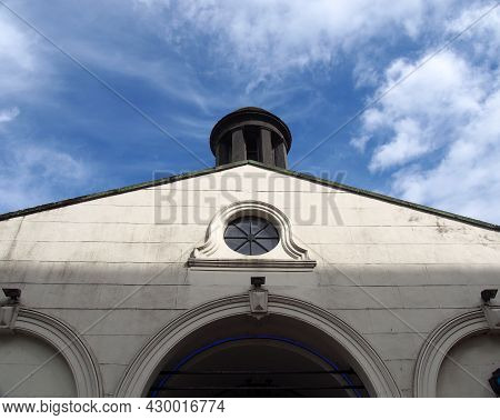 Close Up Of The Front And Cupola Of The Historic 18th Century White Cloth Hall Market Building In Le