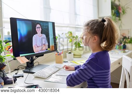 Child Preteen Girl Studying At Home Using Video Lesson On Computer