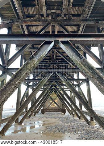 The Underside Of The Old Lighthouse Pier At Tenby, West Wales