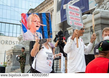 Vancouver, Canada - August 14,2021: Anti-masks Protester Is Holding A Caricature Photo Of Dr. Bonnie