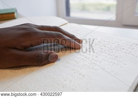 Close Up Of African-american Hand Reading Braille Book For Blind, Copy Space