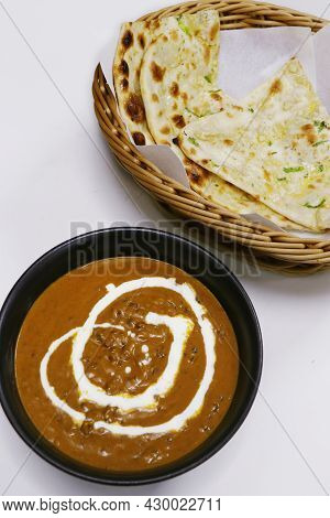 Indian Lentil Curry Known As Dal Makhani With Tandoori Naan Bread