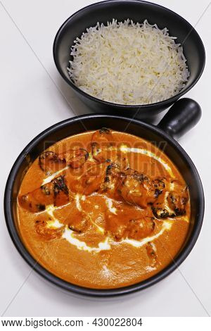 Butter Chicken Curry With Jeera Rice, Indian Food Delicacy, Chicken Cooked In Rich Tomato Cashewnut