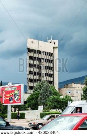 Mostar, Bosnia - June 6, 2008: Main Facade Of The Damaged And Bombed Building Of Sniper Tower In Mos