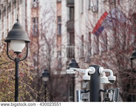 Selective Blur On Dome Cctv Cameras Seen From Afar In Front Of An Old Street In An Urban European Ci