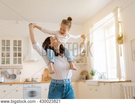 Mom and her daughter child girl are playing. Family holiday and togetherness.