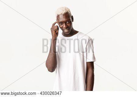 Portrait Of Handsome Thoughtful African-american Blond Guy, Showing Smug Face, Smiling Cunning And P