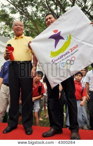 Minister Vivian Balakrishnan Holding Yog Logo Flag