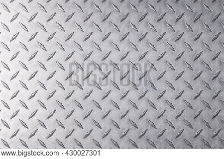 Light Metal Surface, Stainless Steel Plate With A Diamond Pattern. Old Metal Background. Abstract Me