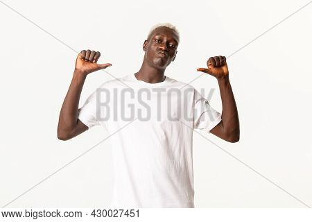Portrait Of Confident Handsome African-american Blond Guy, Pointing Fingers At Himself Sassy And Pro