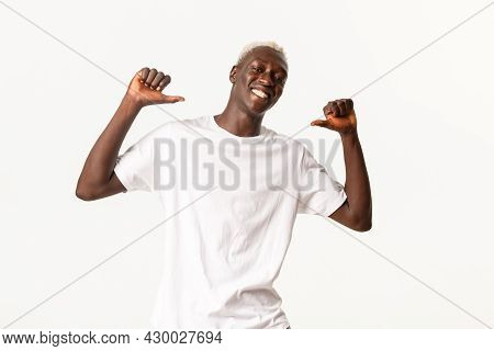 Portrait Of Attractive Confident African-american Blond Student Pointing At Himself And Smiling Prou