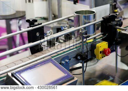 Automated Production Line With Plastic Modular Conveyor Belt. An Empty Tin Can On A Conveyor Belt. S